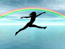 Jumping woman in the rainbow Stock Photos