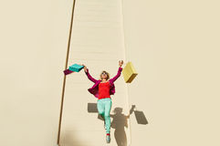 Jumping woman shopping bags Stock Photos