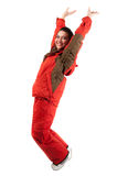 Jumping woman in snowboarding red jacket Stock Photo