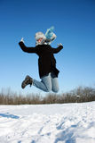 Jumping woman in the snowy forest Stock Images