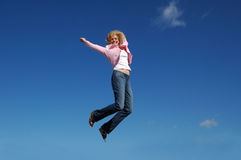Jumping woman on a sunny day Royalty Free Stock Photography