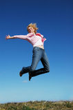 Jumping woman on a sunny day Royalty Free Stock Image