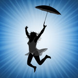 Jumping woman with umbrella Royalty Free Stock Images