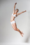 Jumping woman in underwear Stock Photography