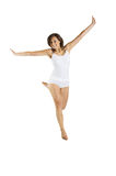 Jumping woman on white background Royalty Free Stock Images