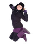 Jumping woman in winter jacket and hat Royalty Free Stock Images