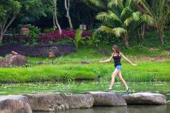 Jumping woman in the Yanoda National Park, Hainan, China. royalty free stock image