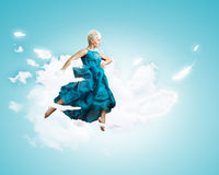 Jumping woman Royalty Free Stock Image