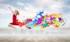 Jumping woman Stock Photography