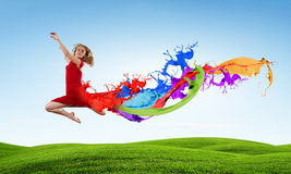 Jumping woman. Young woman dancer in red dress jumping high Stock Photography