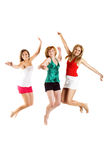 Jumping women on white background. Some beautiful women are jumping isolated on white background Royalty Free Stock Photo