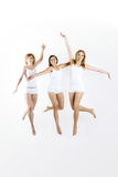 Jumping women on white background Stock Images