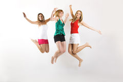 Jumping women on white background Stock Photo