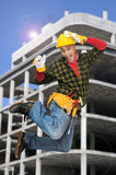 Jumping worker Stock Photo