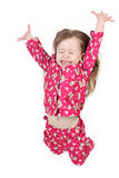 Jumping young girl. Young girl jumping for joy Stock Photos