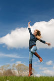 Jumping young girl Stock Photo