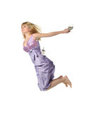 The jumping young girl with shoes in hands Stock Photos