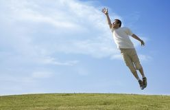 Jumping young man. Young man jump up into sky Royalty Free Stock Photography