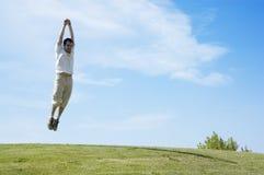 Jumping young man stock photo