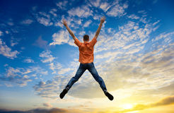 Jumping young man Stock Image
