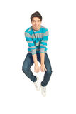 Jumping young man. Cheerful jumping man in motion isolated on white background Royalty Free Stock Photo