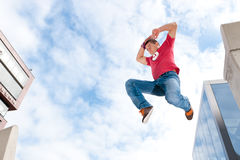 Jumping young man Stock Photos