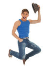 Jumping young man with hat Stock Image