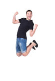 Jumping young man. Isolated over white background Royalty Free Stock Photo