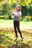 Jumping young redhead teenager woman Royalty Free Stock Photo
