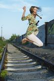 Jumping young woman Stock Images