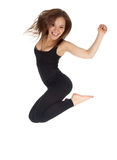 Jumping young woman Stock Image