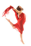 Jumping young woman. In red dress isolated on white background Royalty Free Stock Photo