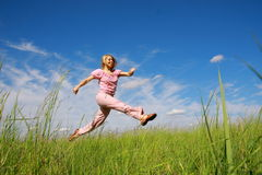 Jumping young woman Royalty Free Stock Photo