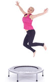 Jumping young woman on the trampoline Royalty Free Stock Images