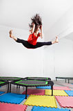 Jumping young woman on a trampoline Royalty Free Stock Image