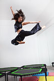 Jumping young woman on a trampoline Royalty Free Stock Photography