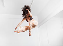 Jumping young woman on a trampoline Royalty Free Stock Images