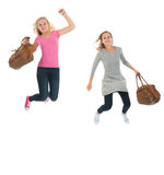 Jumping youth with school bags Royalty Free Stock Images