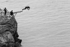 Jumps from Cliff at Howth Dublin County Ireland, Irish Sea stock photos