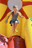 Jumps on inflatable attractions Royalty Free Stock Images