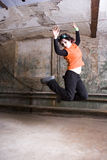 Jumps in old cellar. The girl - Gotha jumps in an old cellar Royalty Free Stock Images