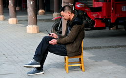 Jun Le, China: Man Using Cellphone Stock Photos
