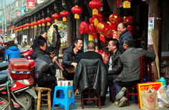 Jun Le, China: Men Playing Cards Stock Photo