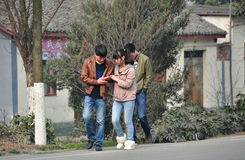 Jun Le, China: Teenagers Walking on Road Royalty Free Stock Photos
