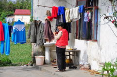 Jun Le, China: Woman Hanging Laundry Stock Photos
