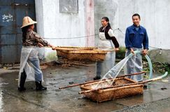 Jun Le Town, China: Washing Wicker Baskets Royalty Free Stock Image
