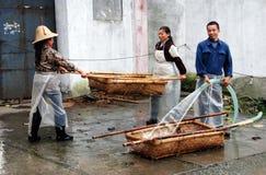 Jun Le Town, China: Washing Wicker Baskets Royalty Free Stock Image