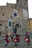 Flag wavers under the Cathedal of lodi, a small city near Milan. royalty free stock image