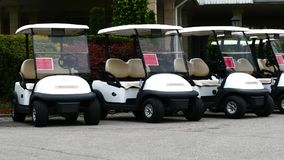 Group of golf cars in front of Aglalrov estate golf club. Stock Photos