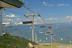 A junction of gondolas and chair lifts at Whistler Mountain. Royalty Free Stock Photos
